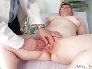 Unattractive mommy gets a swab stick up her hairy pussy